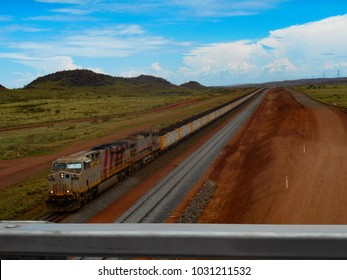 A very long train pulls cargo across the Australian Outback