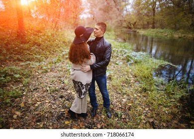 Very loving couple enjoying the outdoors. Beautiful stylish and sweet couple in a relationship. Happy lovers walk in the woods