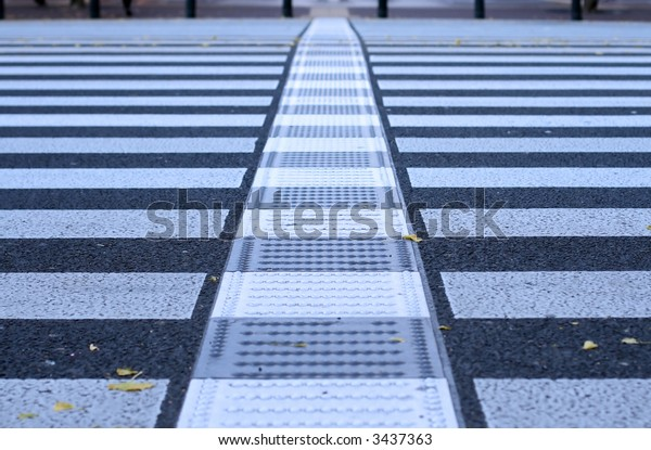 Very low perspective and selective focus of a pedestrian crossing generating an interesting urban abstract.