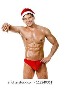 the very muscular  bronzed handsome sexy Santa Claus on white  background, posture and smile, isolated