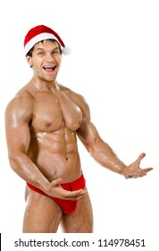 the very muscular  bronzed handsome sexy Santa Claus on white  background, posture and to burst out laughing, isolated