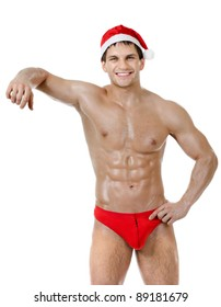 the very muscular  bronzed handsome sexy Santa Claus on white  background, posture lean one's elbows and smile, isolated