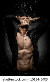 very muscular handsome sexy guy under shower, naked torso