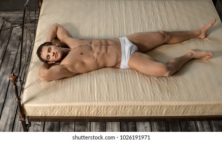 the very muscular handsome sexy guy lie on bed  in  bedroom and sleep