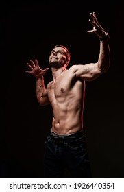 the very muscular handsome sexy guy on black background, naked torso.