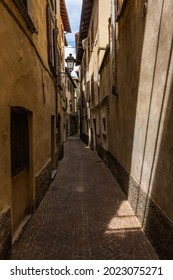 Very narrow alley in Bellano, lake Como, Lombardy, Italy. Narrow alley between the residential buildings in the small town of Bellano by the Como lake, Lombardy, Italy.