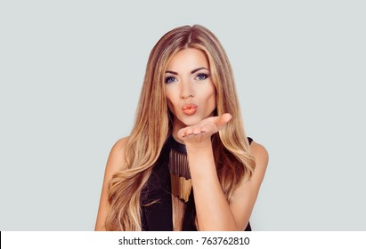 Very nice girl with blue eyes blowing giving a virtual kiss isolated light grey white background with copy space