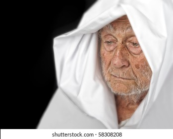 Very Nice Image of an elderly Man with White cape
