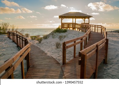 Very nice view of the access to the sea. Wooden sidewalk to the beach. Observation deck on the shores of the Baltic Sea.