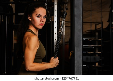 very nice woman strengthens in the gym