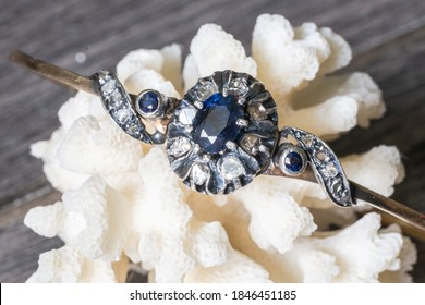 very old 12k gold with diamonds and sapphires