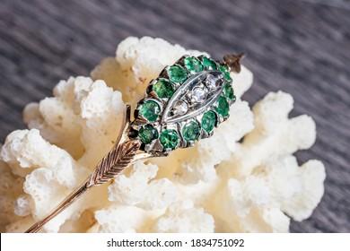 very old 12k gold emeralds and diamonds bracelet