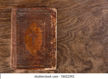 very old aged brown bible on wooden table
