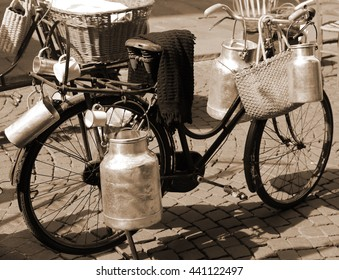 very old bicycle of milkman for transporting milk cans