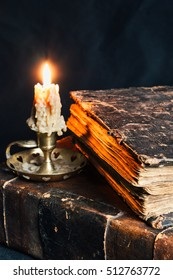 Very old books with candle