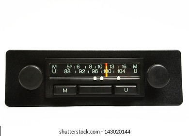 A very old car radio receiver isolated on white background - front panel view.