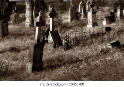 Very old cemetery, in sepia with soft focus
