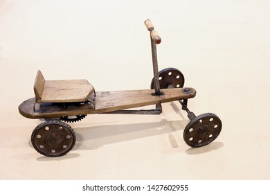 Very old child quadricycle in iron and wood