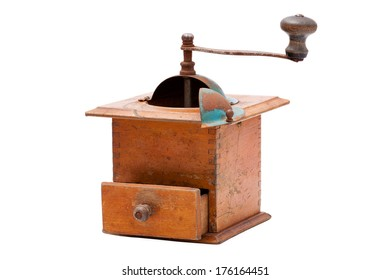 Very old coffee grinder with open drawer isolated on white background