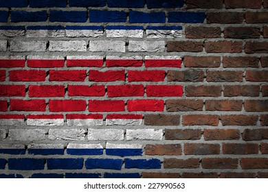 Very old dark red brick wall texture with flag - Costa RIca