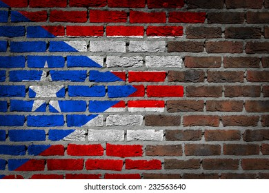 Very old dark red brick wall texture with flag - Puerto Rico