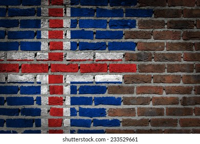 Very old dark red brick wall texture with flag - Iceland