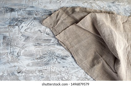 very old gray vintage kitchen towel on gray cement background, top view, copy space