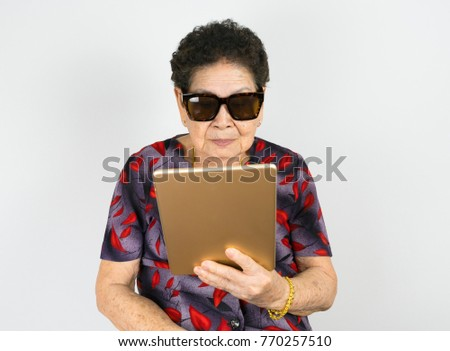 8fb835f5690f very old happy asian chinese yellow brown tan skin elderly woman wearing  sunglass smiling and using