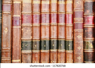 very old historic ancient books on a shelf