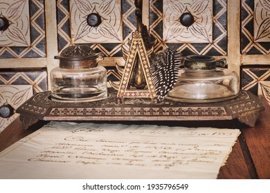 Very old inkwell next to original 16th century manuscript