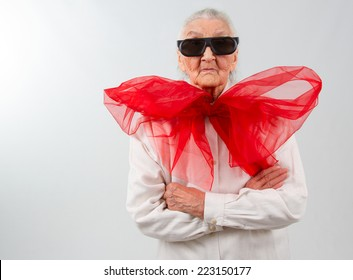 very old lady witha  huge red bow and  eyeglasses