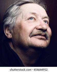 Very old man portrait on dark background