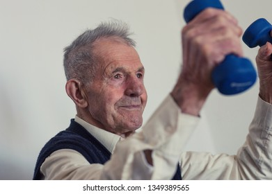 Very old man successfully lifting weights