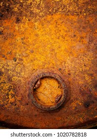 Very old metal tank lid with thick rusty and rough surface.