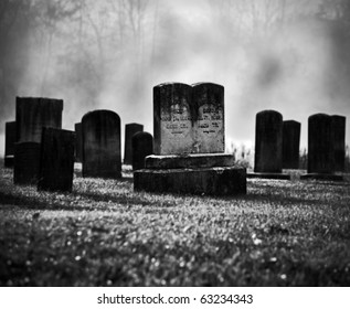 Very old misty and creepy graveyard in black and white