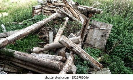 Very old North wintering log cabin collapsed. In such small dwellings poor forest people lived few hundred years ago because heat preservation in winter, Northern edge and northern people in hamlet