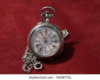 Very old pocket clock with the chain