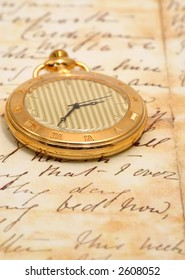 very old pocket watch in a vintage romantic letter