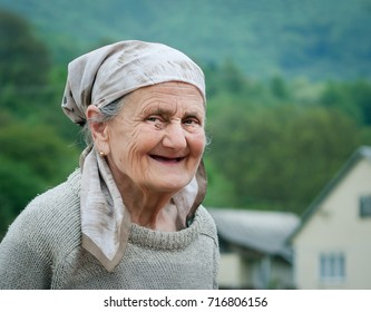Very old rural woman smiling outside during the day