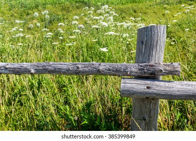 A very old rustic wooden pole fence