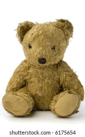 a very old and shabby teddy bear on white