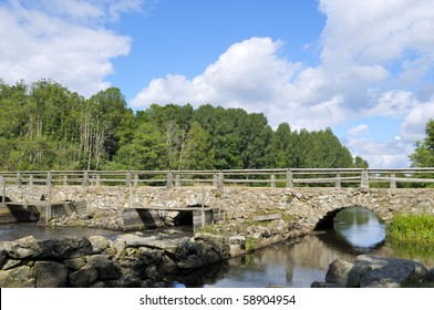 A very old Stone arch Bridge over the Moerrum river by Ryd Sweden.