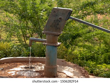 Very Old Vintage Hand Manual Pump also known as Indian Mark II - This One is a working pump used from 1970 till now in bore well area to pump out the water from ground water Tamilnadu India South Asia