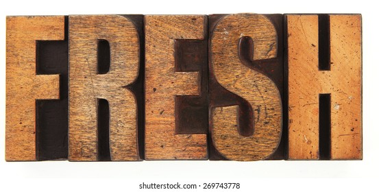 Very Old Vintage Letterpress letters spelling out Fresh