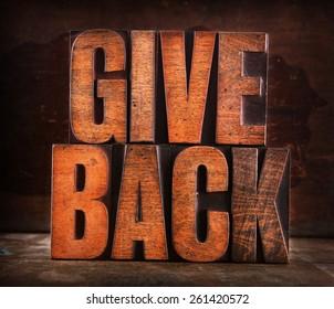 Very Old Vintage Letterpress spelling out Give Back