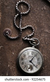 very old watch on the grunge post card
