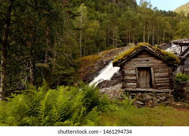 Very old watermills with grassy roofs in Norway. Ancient buildings.