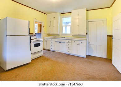 Very old white and yellow kitchen. Build in 1907 old farm house in Ashford, Washington State near Mt. Rainier.