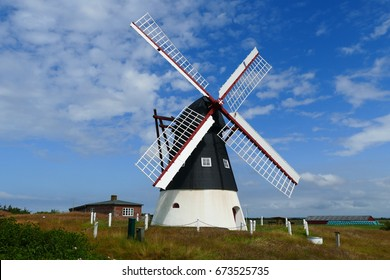 Very old windmill on the Mandoe island in the wadden sea of Denmark, Europe, built in the year 1830