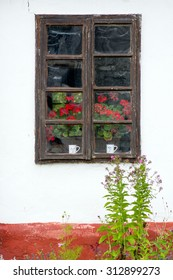 very old window on white wall